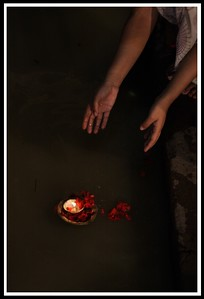 A traditional light immersed in the waters of Ganges